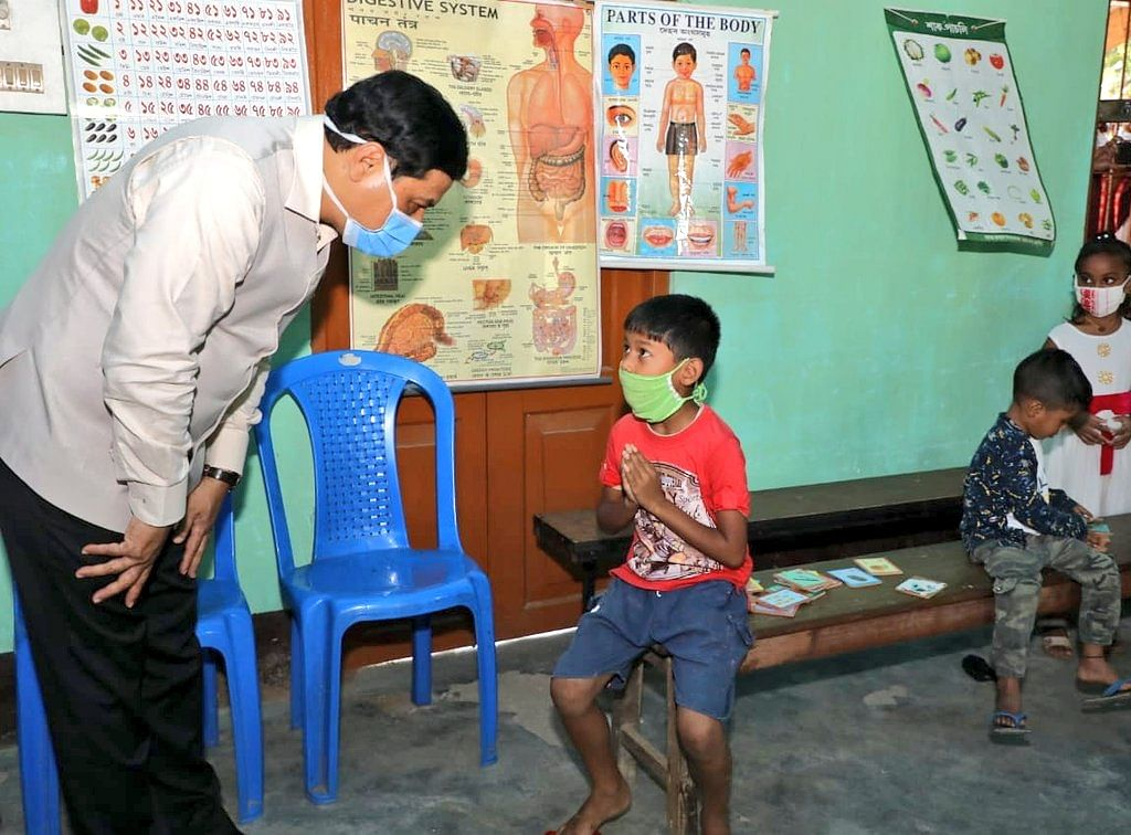 CM Sonowal interacting with a child inmate in a relief camp