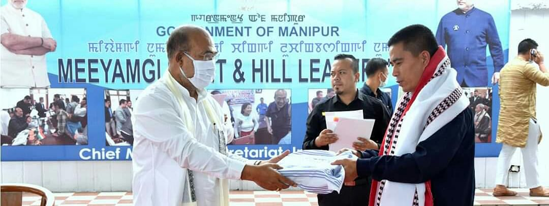 Chief minister N Biren Singh (L) with one of the leaders of a hill district of Manipur on Wednesday