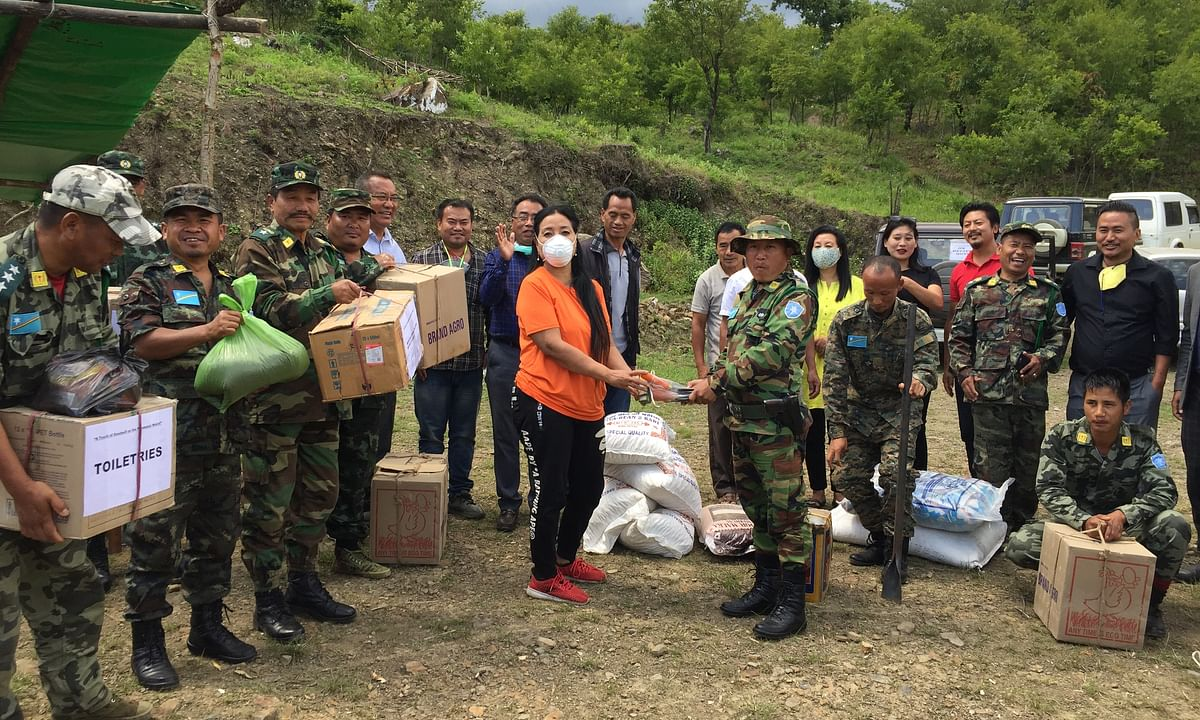 Manipuri Nagas handing over relief items to NSCN-IM cadre in Senapati district on Friday