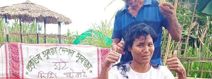 Environment worker NIjara Phukan tonsures her head as part of protest against the Centre move on Dehing Patkai