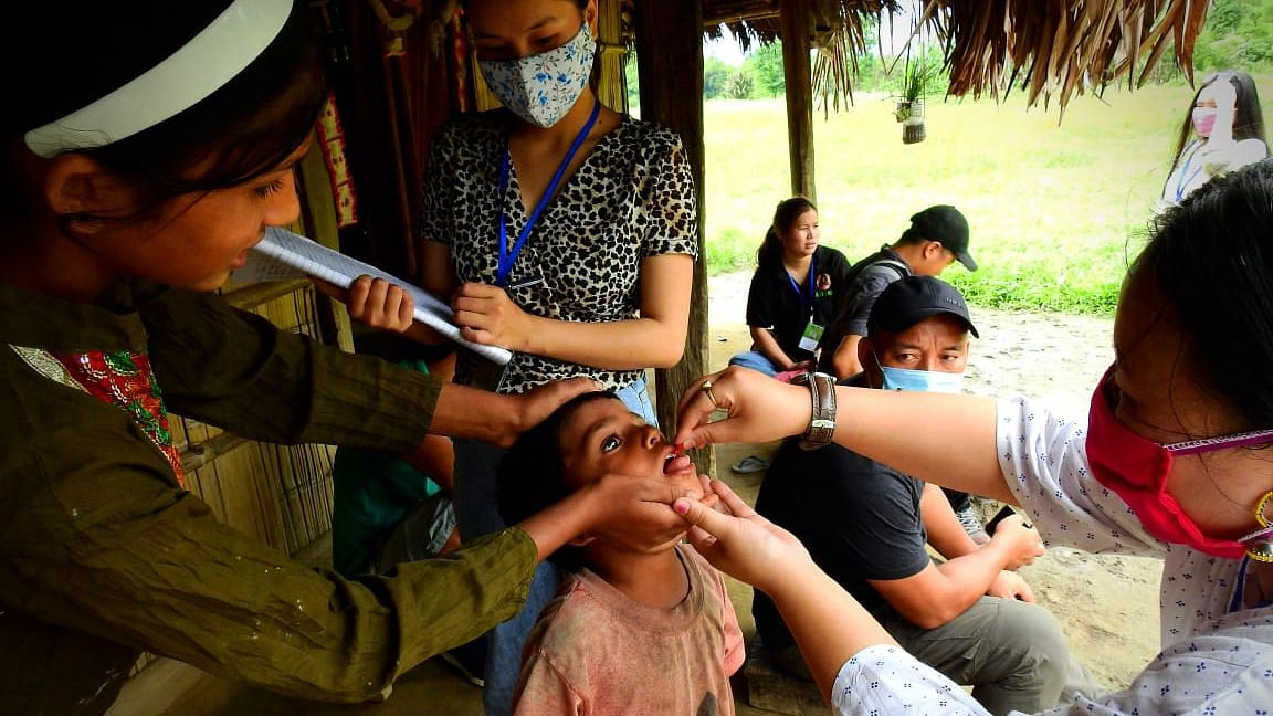 Volunteers providing routine immunization, Vitamin A and deworming supplements to children in Arunachal Pradesh's Lower Dibang Valley district amid COVID-19 lockdown