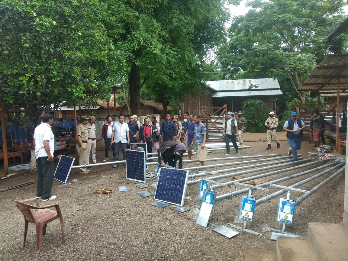Minister Letpao Haokip providing solar lamp posts to villagers along Myanmar border