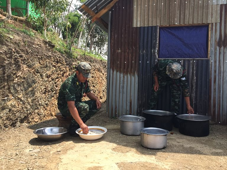 NSCN-IM rebels preparing lunch at the designated camp in Manipur's Chandel district