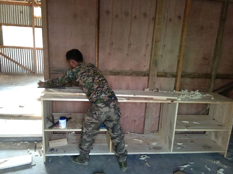 A member of the Naga armed group engaged in carpentry at the designated camp in Manipur's Chandel district