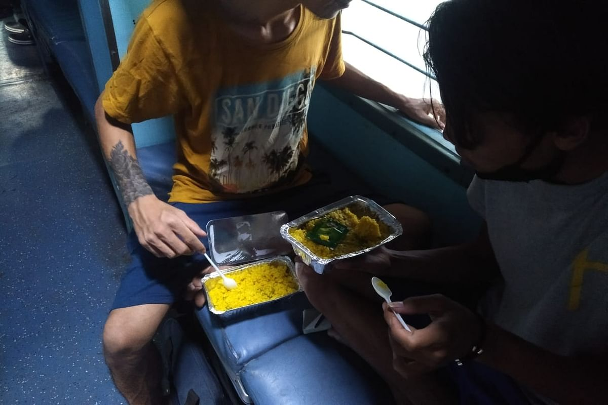 Passengers having their meals en route to Manipur from Chennai