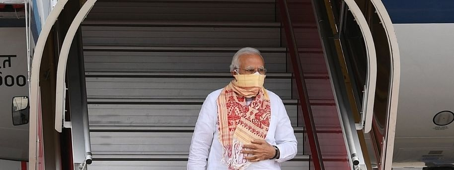PM Narendra Modi seen covering his face with an Assamese 'gamusa' during his recent visit to West Bengal to assess the situation after cyclone Amphan left a trail of devastation in the state