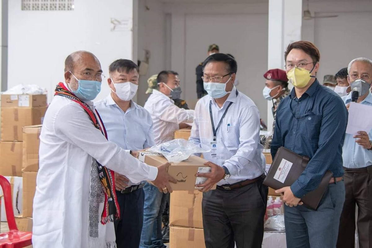 Manipur CM N Biren Singh (left) and Dr Lorho S Pfoze (2nd from left) handing over medical kits to officials