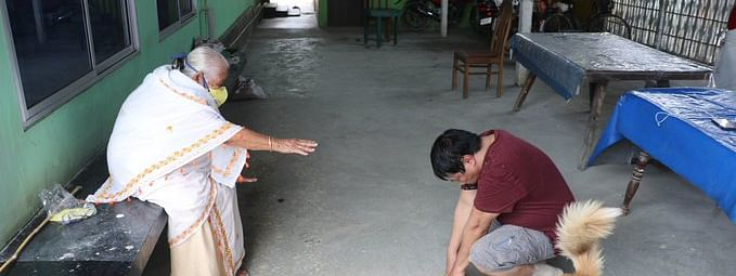 Assam minister Atul Bora seeking blessings from his mother while keeping a safe distance