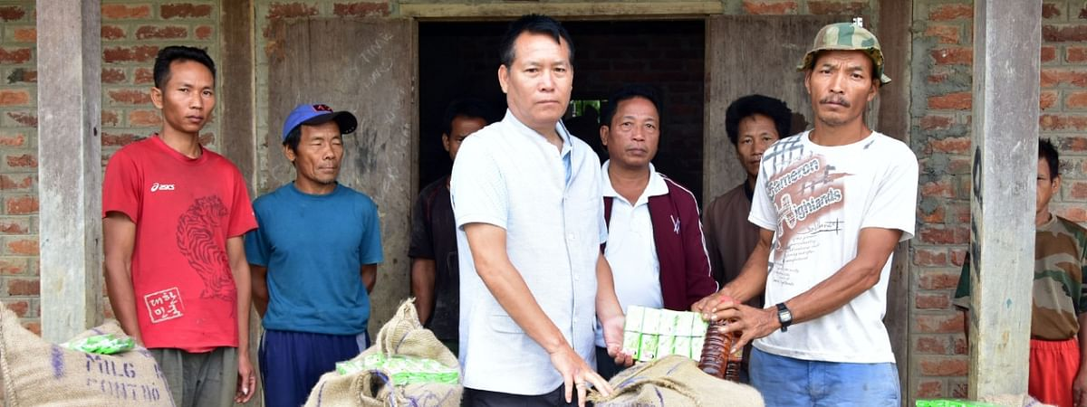 Minister Letpao Haokip (L) and locals in Manipur's Chandel district