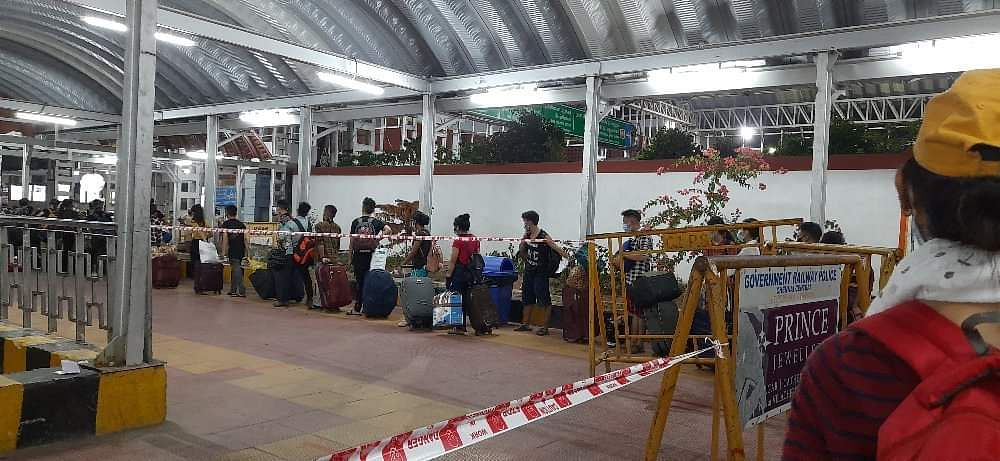 Stranded students from the state of Nagaland waiting in line to get screened and to board the train to Dimapur on Tuesday night at DR. MGR Chennai Central Railway Station.