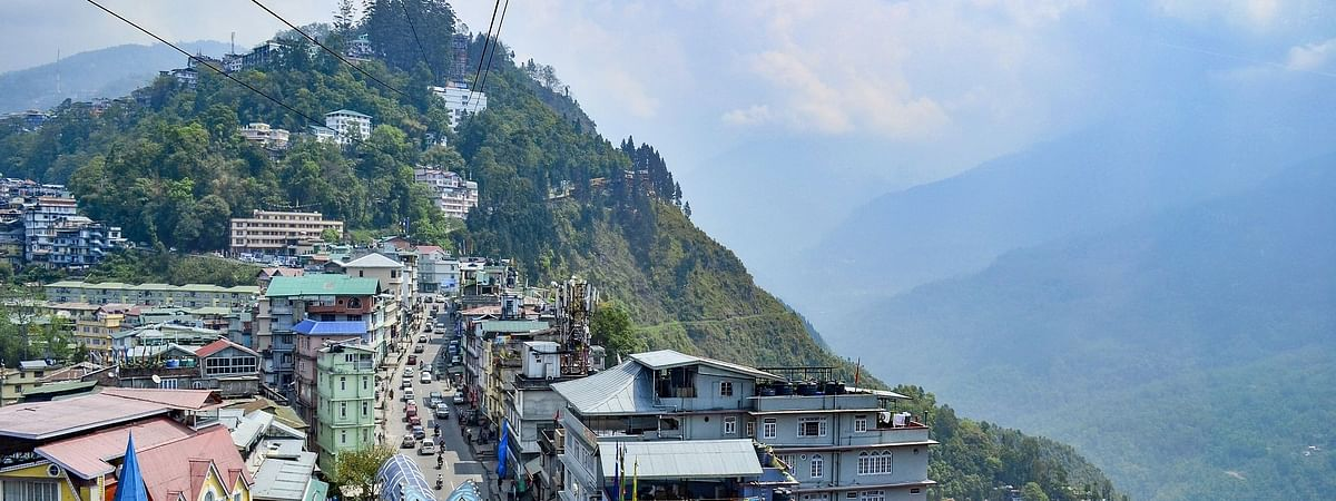 Sikkim sits isolated above Gorkhaland Territorial Administration and  is internationally bordered by Bhutan, Tibet and Nepal in east, north, and west, respectively