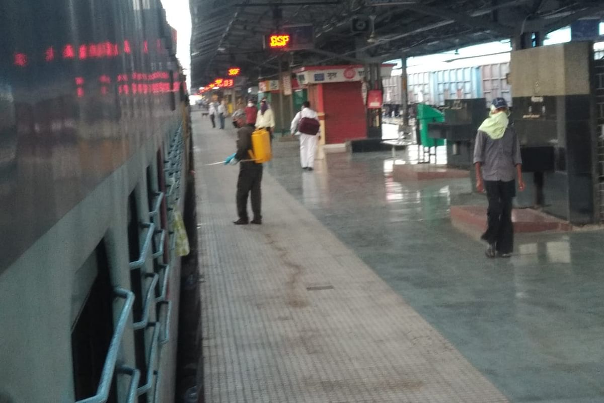 A railway worker disinfecting the train at Raipur railway station on Monday
