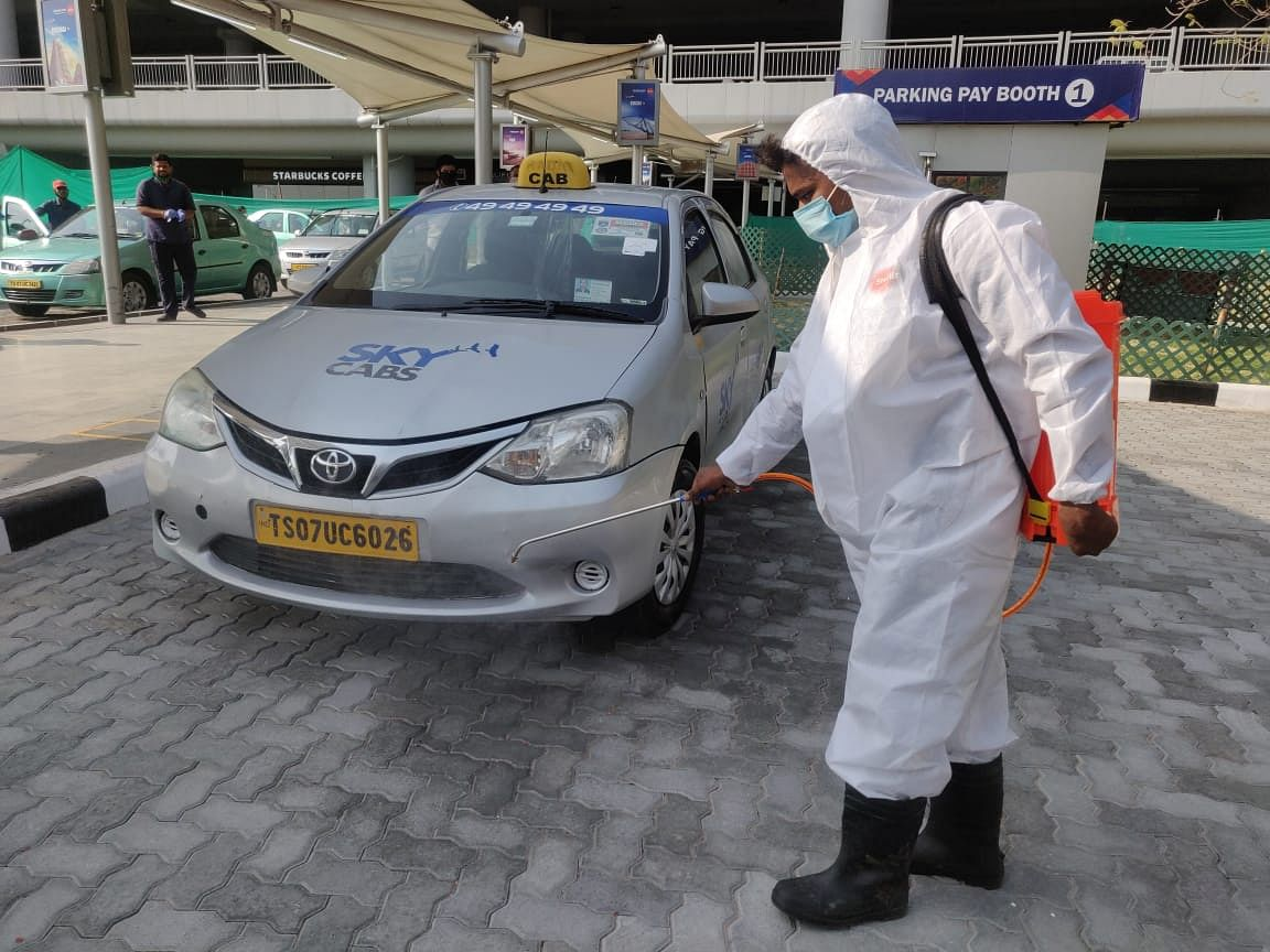 Airport staffers disinfecting the premises in Hyderabad Airport