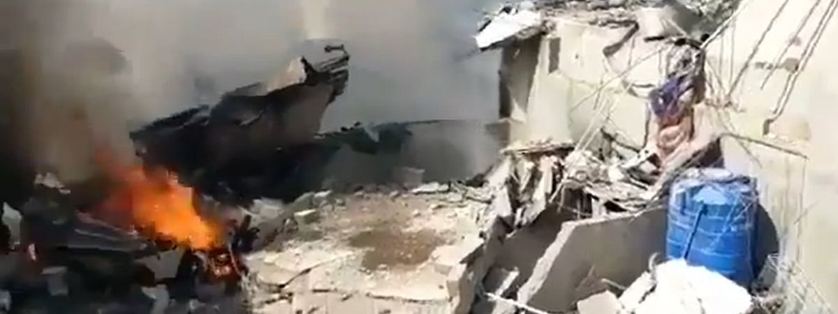 Footage from local TV channels showed the airline crashed into a residential area and smoke was rising from the crash site.