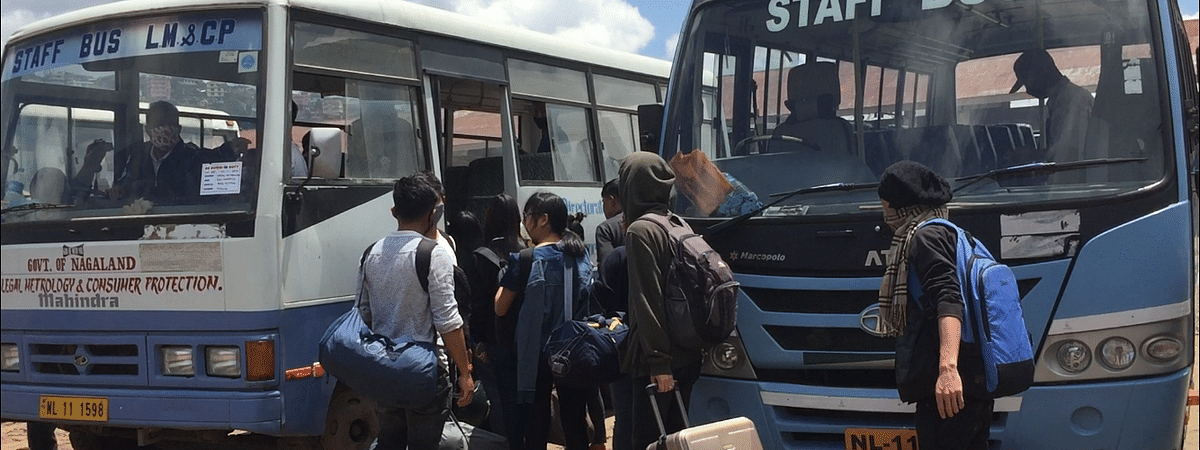 Stranded students boarding a bus to Wokha in Kohima on Thursday