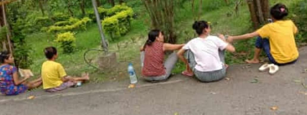 A picture of five girls sitting on the road inside Tezpur University campus in Assam's Sonitpur district without wearing their masks is going viral on social media