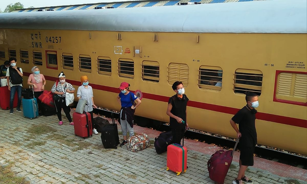 Stranded returnees lining up at Jiribam railway station in Manipur upon arrival