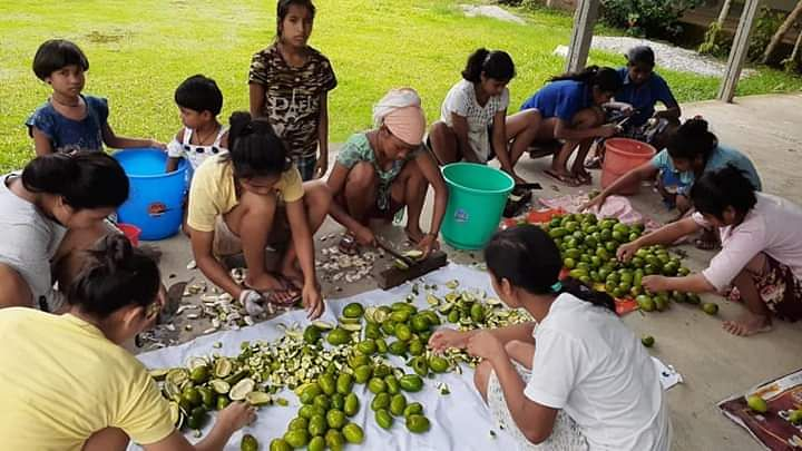 Members of Nedan Foundation, a Kokrajhar-based NGO, busy in preparing the pickles