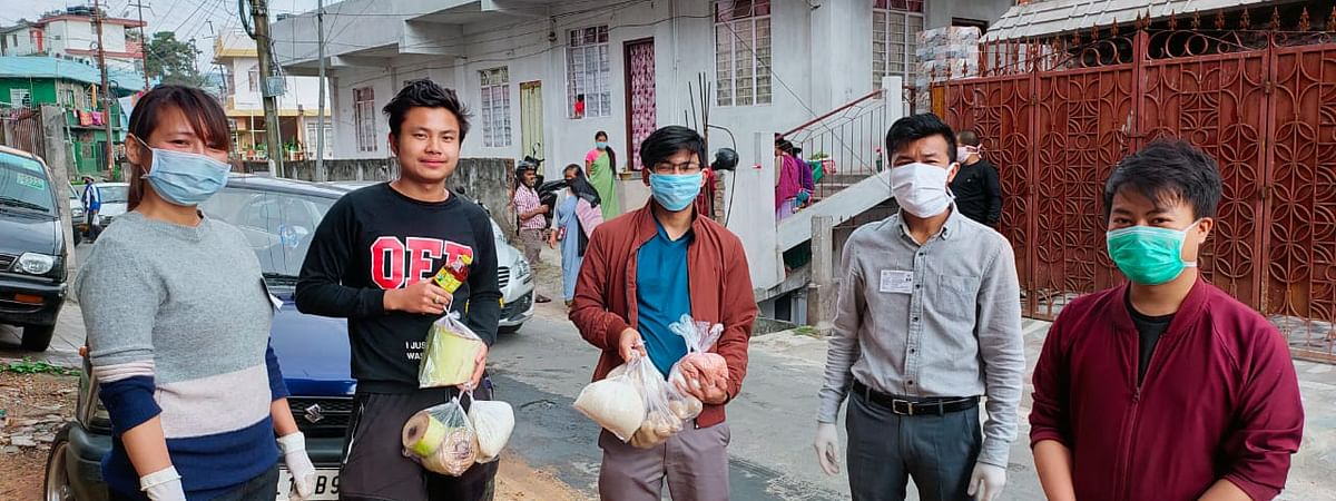 Students from Manipur receiving food packages in Meghalaya