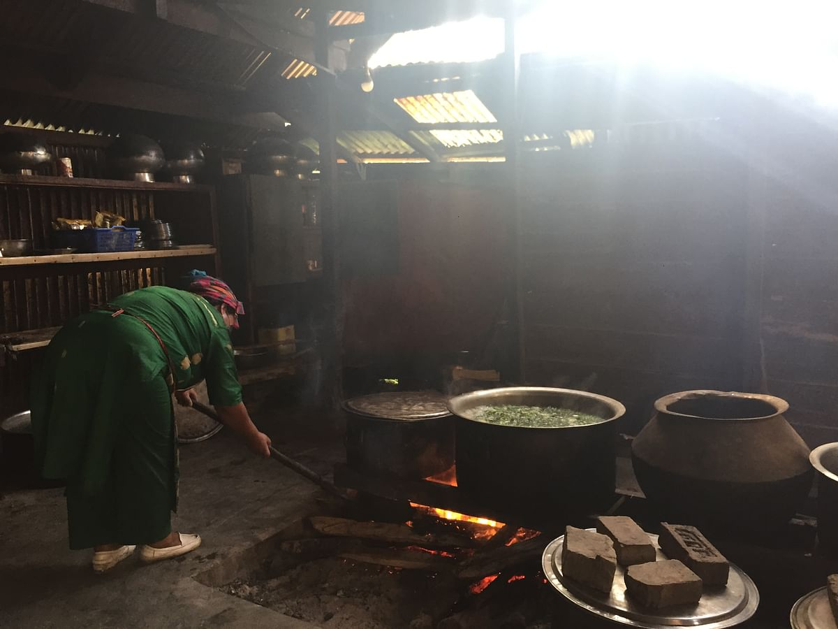 A woman working at the kitchen in Ukhrul