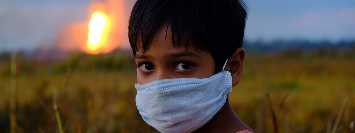 Stuck between the pandemic and the gas well fire, a child echoing his fear of an uncertain future