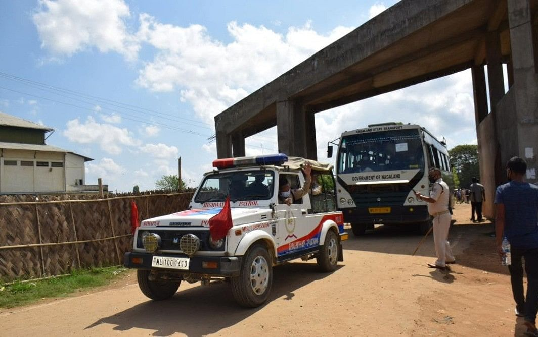 The first bus with stranded people leaving for Mon with police escort on May 7