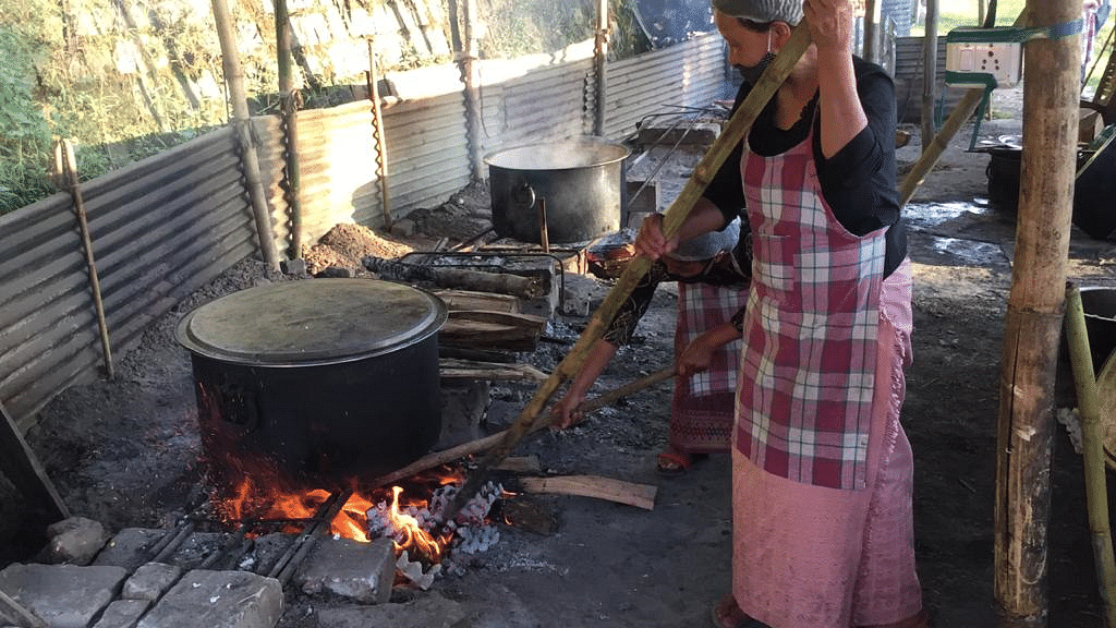 A woman cooking rice at Bethel Kitchen in Kohima