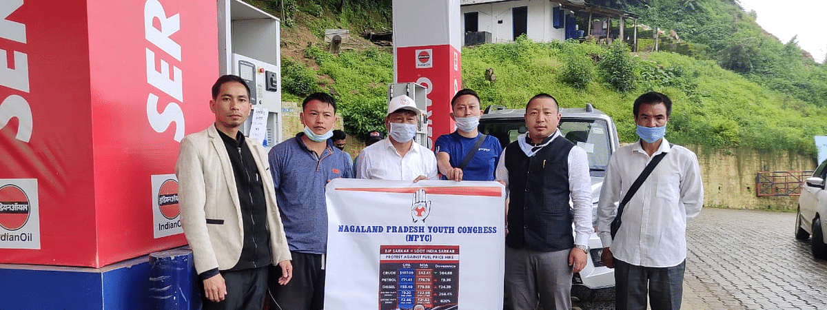 NPYC president Vilhousielie Kenguruse (second from right) and others outside a petrol pump in Kohima