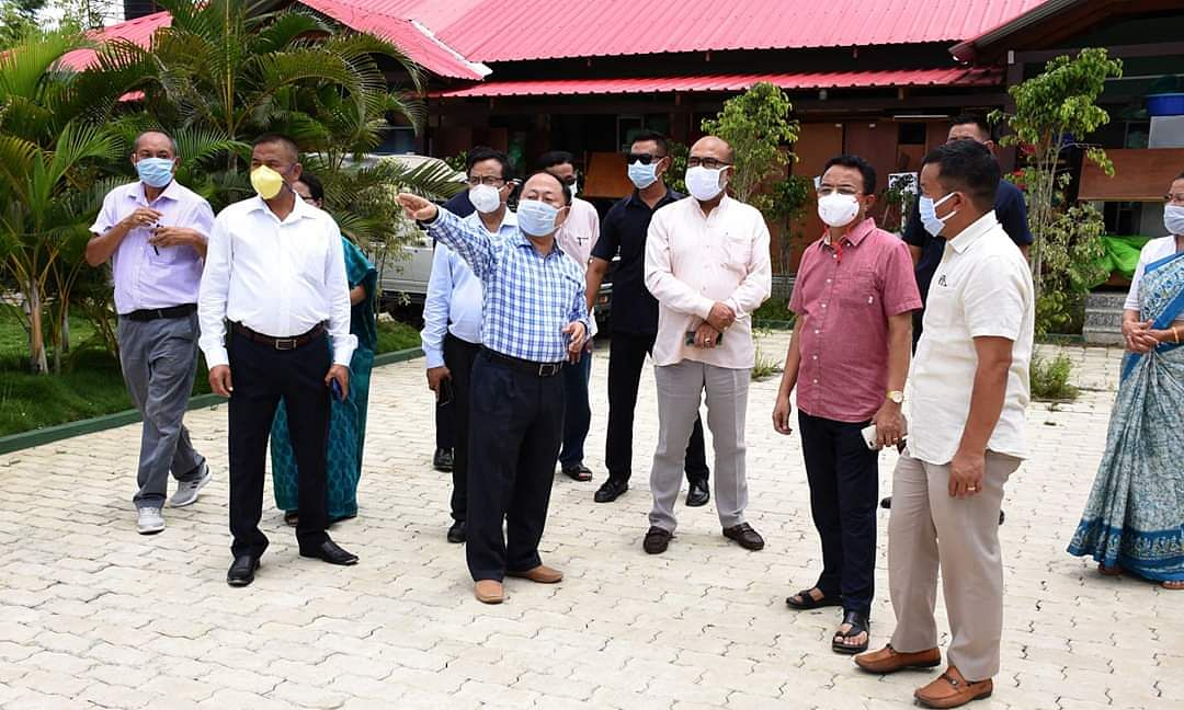 Manipur CM N Biren Singh along with health officials inspecting the new COVID-19 Care Centre at UNACCO School in Imphal West on Saturday