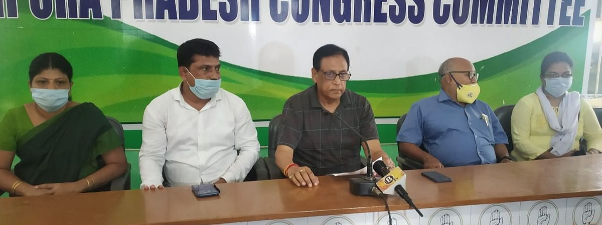 Tripura Pradesh Congress President Pijush Kanti Biswas (middle) addressing a press conference on Monday