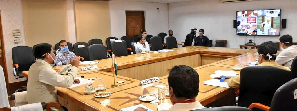 Assam CM Sarbananda Sonowal and others interacting with PM Narendra Modi and his team