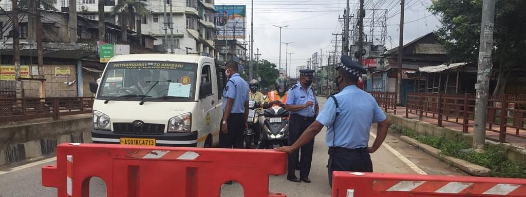 Traffic police personnel checking vehicles