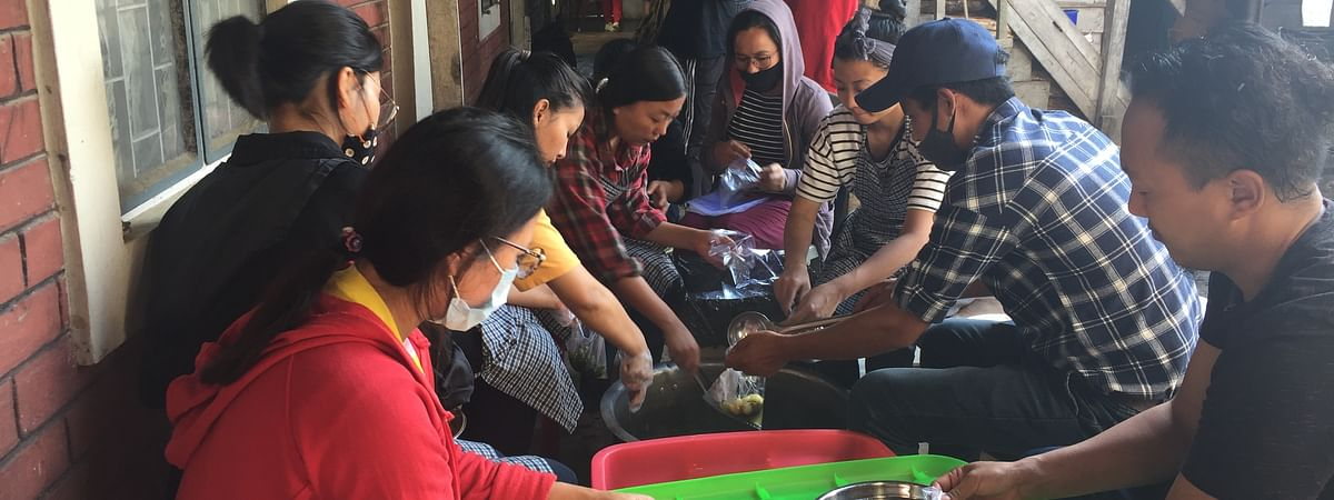 Youth volunteers packing food for quarantine inmates in Manipur's Ukhrul