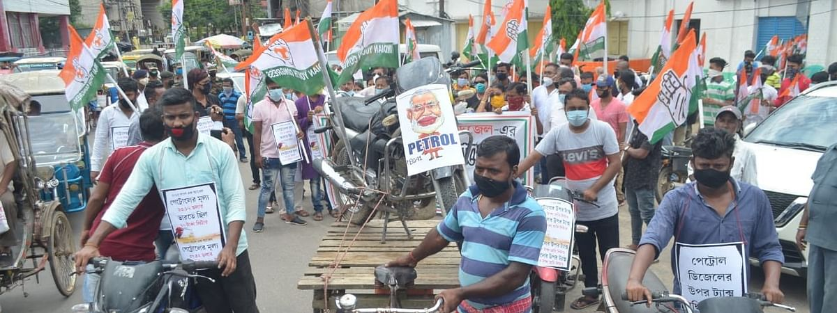 Tripura Congress workers staging protest against fuel price hike in Agartala on Monday