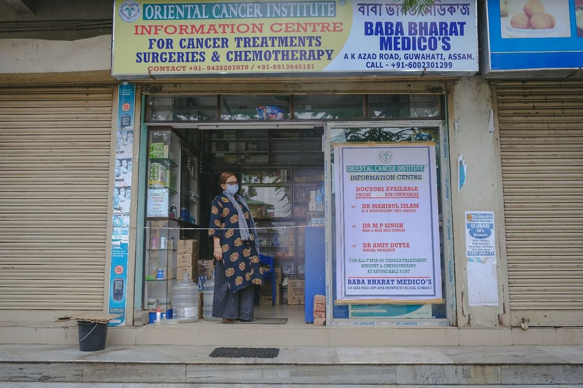 Only pharmacies and hospitals are allowed to remain open but with no one out on streets this shop owner holds a solemn look