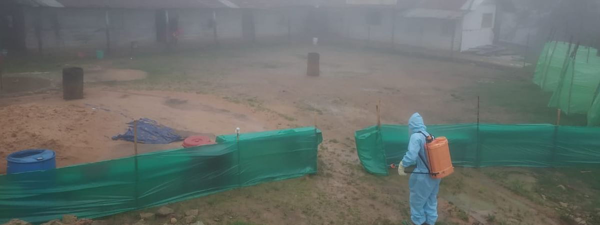 A volunteer disinfecting the surrounding of the community quarantine centre at Hungpung village in Ukhrul district on Saturday