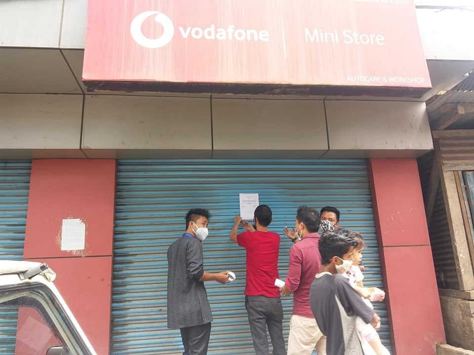 Students shutting down a Vodafone Mini Store in Mokokchung