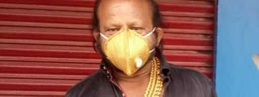 The gold mask has an N95 mask below, and weighs around 100 gm