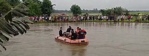 SDRF personnel undertaking rescue operation in the river