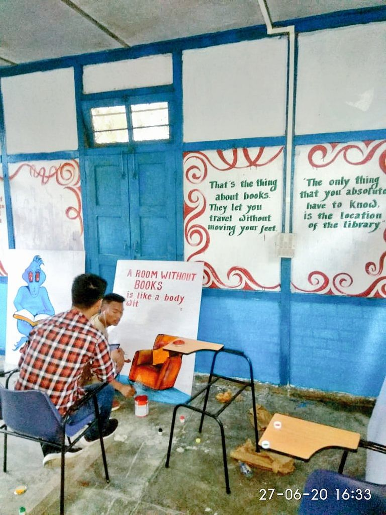 Local youths modifying the hall with their artistic touch.