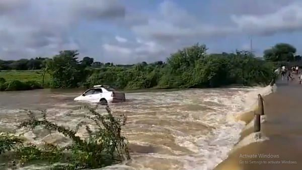 WATCH: Car gets washed away as it tries to cross overflowing water