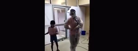 The frontline worker was dressed in full PPE kit while cheering the young inmate