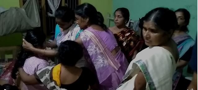 Relatives and others are trying to console wife of the martyr, Jumi Kalita at her residence on Thursday night