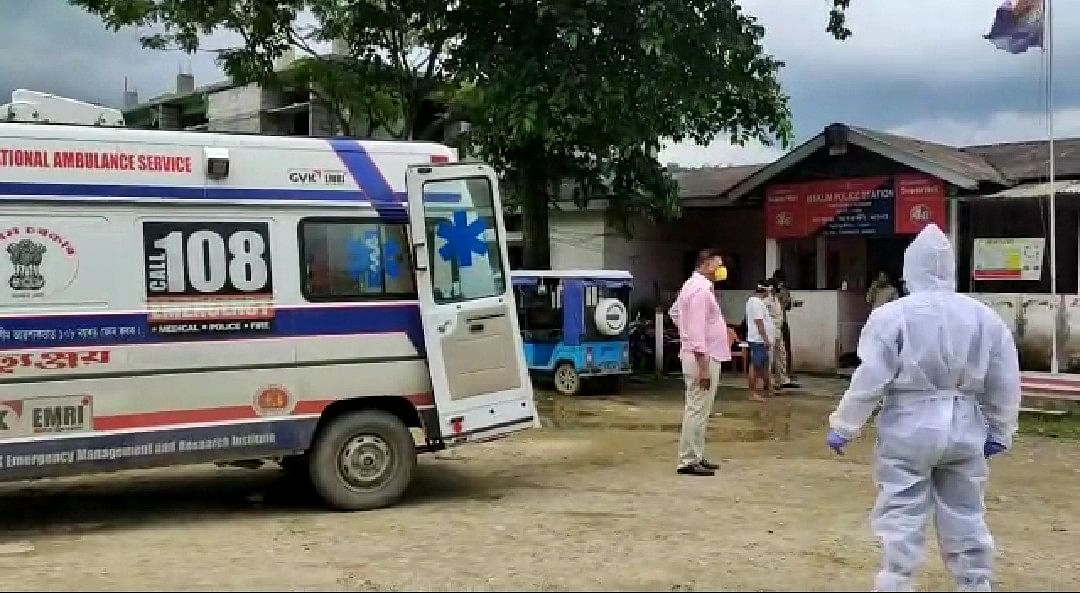Ambulance taking police personnel from Makum police station after they tested positive