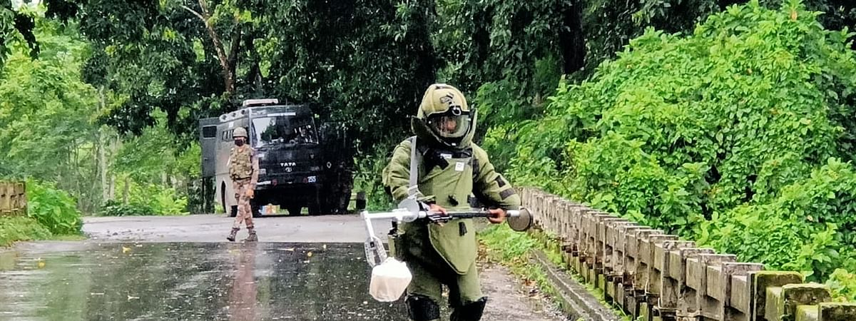 Member of the bomb disposal squad with the recovered IED