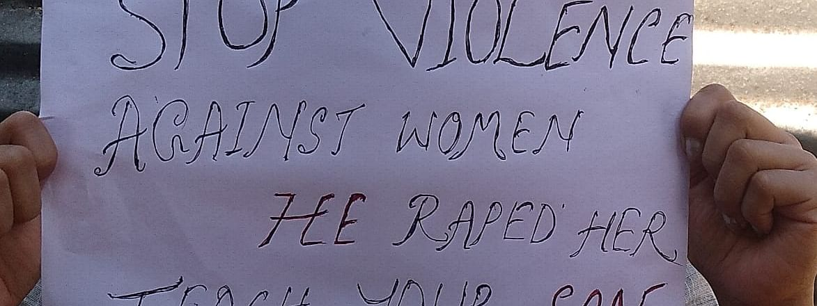 A student from Tripura University protesting against gang rape of 17-year-old girl
