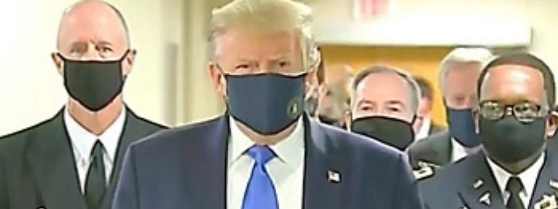 US President Donald Trump's navy blue/ black mask featured the presidential seal on the left