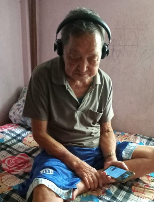 A senior citizen listening to the Behliangchhip Radio in Behliangchhip village in North Tripura district of Tripura