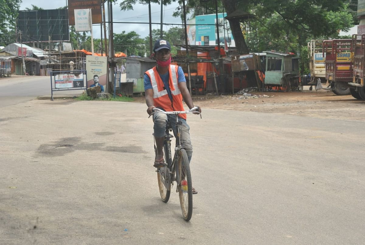 An Agartala Municipal Corporation worker on his way home after completing his work on Sunday