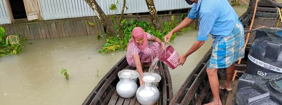 PHE dept distributing water to affected villages in flooded areas